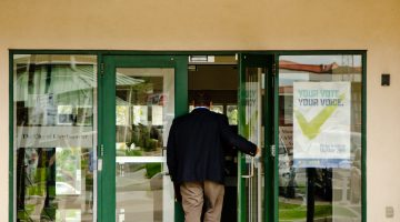 Mayoral candidate Gerald Aalbers opens the door of City Hall in a Goat News file photo. Photo by James Wood/106.1 The Goat/Vista Radio