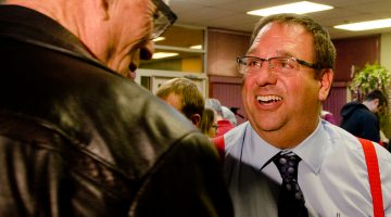 Newly-elected Lloydminster mayor Gerald Aalbers is congratulated by former council member Herb Flieger at the Legacy Center on the evening of October 26, 2016. Photo by James Wood/106.1 The Goat/Vista Radio